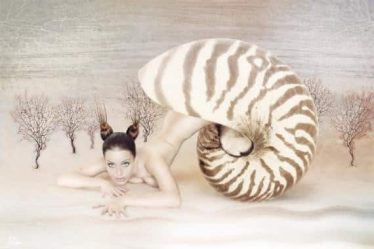 A woman coming out of a shell, representing birth